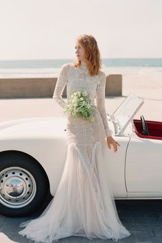 "From the editorial ""When High Fashion Meets the Sea... This Editorial Is Every Modern Bride's Dream Beach Wedding."" This retro, high-neck, lace wedding dress by Costarellos was the perfect touch for this beach inspired editorial ✨  Photographer: @lauramurray Gown: @costarellos  #weddingdress #bridedress #bridalfashion #beachweddingdress #weddingeditorial"
