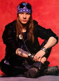 Axl Rose. Abrasive, crude, rude, probably the only person I know that has a worse temper than me. BUT...decent singer, definitely talented, good showman.. when he could get over his ego. G n R was one of my favorite bands in high school, still like them..