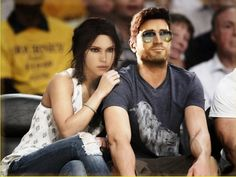 What people do with their time cracks me up! No matter, I love this! :D Nathan Drake and Lara Croft (at a Knicks game!)