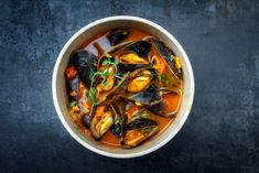 Traditional French Corsican mussel stew with mussels as top view in a pot with copy space , Green Eggs, Mussels, Mediterranean Recipes, Fish And Seafood, Ratatouille, Chicken Wings, Stew, Ethnic Recipes, Top View