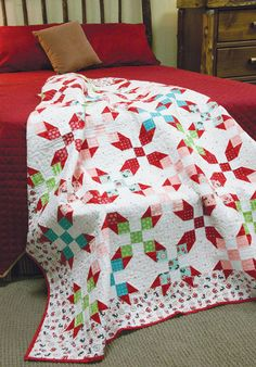 When Nine-Patch and Snowball Blocks are set together in this fun design, the stars come out! Red Hots is a modern update to a classic design, an instant heirloom for your family to enjoy.