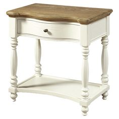 One-drawer night table with turned legs and a bottom display shelf.   Product: NightstandConstruction Material: E...
