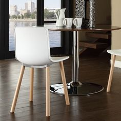 Shop for Sprung White Plastic Modern Dining Chair. Get free shipping at Overstock.com - Your Online Furniture Outlet Store! Get 5% in rewards with Club O!