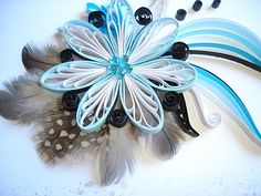 blue flower with feathers this would make a cute little girls hair bret.