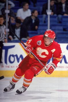 Canadian hockey player Theo Fleury of the Calgary Flames on the ice during a game early Ice Hockey Teams, Hockey Mom, Flames Hockey, Canadian Hockey Players, Patrick Kane Hockey, Hockey World, Jonathan Toews, National Hockey League, New York Rangers