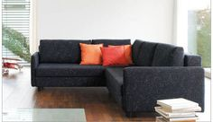 """Sectional sofa with slender foldable armrests.    SONA comprises a modular sofa with a corner sofa and bed functionality.    A small tray can be put on the backrest.    Price for sofa in fabric E (as seen on the main photo) $6085.    Dimensions 227 x 251 cm / 89 x 99 """""""