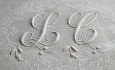 Monogram LC with foliage detail on fine linen damask naopkins sold by chatelaine-chic.