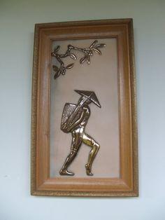 Vintage wood pressed floral pattern frame surrounds molded plastic Oriental scene of fruit tree branch and man with harvest basket  Light
