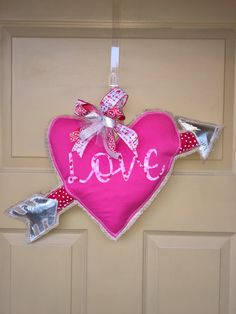 A personal favorite from my Etsy shop https://www.etsy.com/listing/588143061/burlap-door-hanger-valentines-heart-with