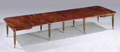 A fine quality early 19th Century Regency period mahogany extending telescopic-action Dining Table in the manner of Gillows of Lancaster, having rounded edge rectangular top retaining 6 original leaves, supported on 8 turned reeded legs ending on original brass castors. The centre removable leg a period replacement. Min – 5ft3ins (160cms) – 7ft3ins (221cms) – 9ft2ins (279cms) – 11ft1ins (338cms) – 13ft (396cms) – 14ft3ins (434cms) – 15ft (457cms) – Max. Circa: 1820