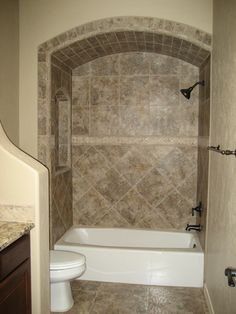 Bath Tub Tile Surround - Love the arched alcove and the tile. The tub itself is awful (it and the toilet don't match the tile).