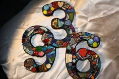 Wild and funky colors and shapes in this custom set of mosaic numbers......$24.00