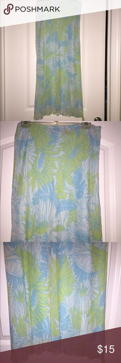 Lime Green and Blue Floral Skirt Elastic at waist. Flowy with slits up both sides. Hangs mid calf. In excellent condition. Material is 100% silk lining and 100% polyester shell. Express Skirts Midi