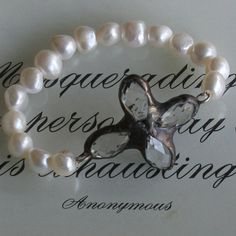 pearl bracelet with crystal cross...