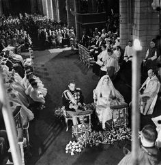 Monte Carlo, Monaco: Flower girls, page boys, and bridesmaids sit in the background and Prince Rainier and Grace Kelly sit before the altar during their wedding ceremony in the Catheral of St. Nicholas, April 19, 1956. They were joined in wedlock in a double ring ceremony following their previous day's civil ceremony.