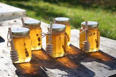 Lavender Infused Honey with wooden honey by Bee Lovely Botanicals.  See beelolvelybotanicals.com for more delicious honey products.