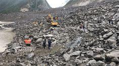 15 dead, over 100 missing in China landslide https://www.yahoo.com/news/over-140-people-feared-buried-china-landslide-050509104.html?utm_campaign=crowdfire&utm_content=crowdfire&utm_medium=social&utm_source=pinterest