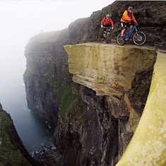 Head over to @earthfocus and give them a follow if you want to see more adventure inspiration! In 2007 Victor Lucas had to walk, crawl, and poke his head out over the airy 600-foot precipice of western Ireland's Cliffs of Moher to shoot Mountain Bike Hall of Famer Hans Rey and 2006 Downhill World Cup champion Steve Peat riding the five-foot ledge. Photo by: Victor Lucas