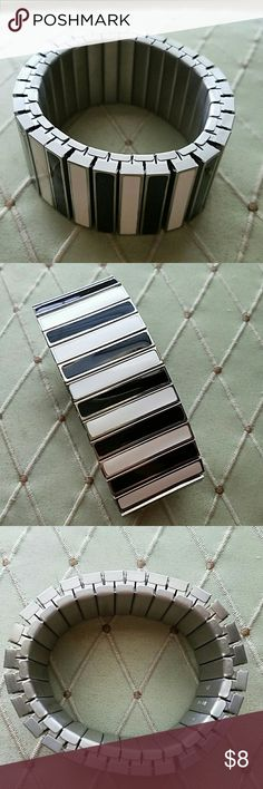 Black & White Silver stretch band with gorgeous ceramic bands of black and white. Simona Collini Jewelry Bracelets