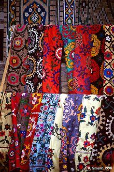 Traditional Uzbek fabrics sold at a Samarkand market