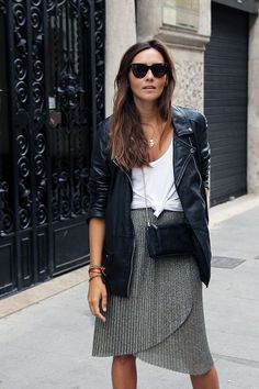 metallic pleated skirt, knotted t-shirt, and black leather jacket