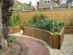 Raised Vegetable Beds | Raised Vegetable Beds  Use the shaping of the raised bed to make areas more symmetrical or to flow better