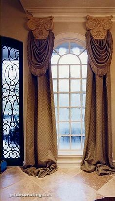 .window treatments and door. would like to see dark wood on the window and trim work