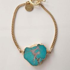 Long Lost Jewelry turquoise/gold stone bracelet.