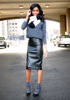 Large scarf, leather skirt, strappy heels, grey slouched socks