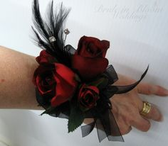 Red rose black feather wrist corsage black by BrideinBloomWeddings                                                                                                                                                                                 More