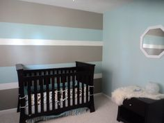 My son's first nursery...Hubby and I painted 3 toned horizontal lines for a…
