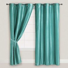 turquoise curtains and cushions