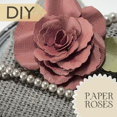 Gorgeous paper roses; full tutorial at http://savedbylovecreations.com