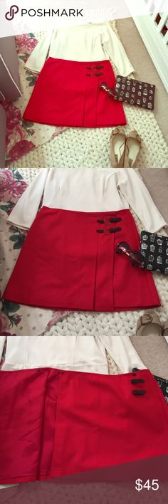 """Closet Cleanout!🎉 Limited Wool Wrap Skirt Perfect red wool wrap skirt by The Limited; two snap closures at the waist of the skirt secure the front pieces (see picture 3 for the skirt """"undone"""") and two brass ring/suede strap closures secure the wrap when fully snapped. Perfect for autumn with heels or high boots; flirty, fun and cozy, it would be an ideal pairing to your weekend strolls in the leaves with a pumpkin spice latte. Fully lined; perfect condition. Only worn once. 17 inches across…"""