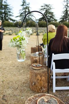 Country Wedding the stumps would be really cute with some kind of candles in mason jars or sumthing