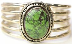 sterling silver cuff bracelet with green stone