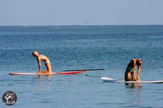 Both yoga and stand up paddle boarding are great for building better balance ...