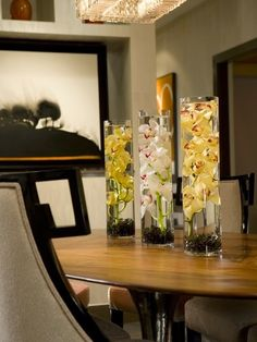 A Long Tubular Vase Filled With Stones And Water Is Perfect For An Orchid Stem The Centerpiece Created By Simply Repeating Look Trio Of