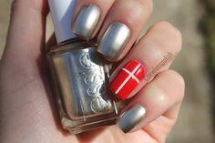 Patriotic flag nail art Danish flag on ring finger with shiny metallic nails. #denmark #danishflag #nailart #metallicnails