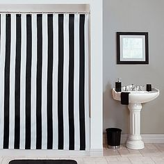 The black and white vertical stripes on the Gramercy Stripe Shower Curtain affords sophisticated elegance with a contemporary flair. This 100% cotton shower curtain with black and white stripes provides a clean accent to enhance any bathroom décor.
