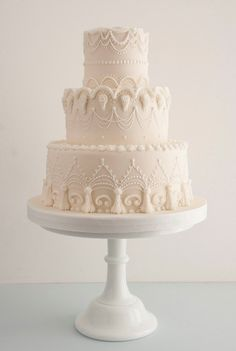 Return to tradition with all white wedding cakes with ornate royal icing details #cake #trend #2016 - For your piping needs, check out The Vanilla Valley - http://www.thevanillavalley.co.uk/icing-bags-nozzles.html