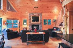 Open floor living room, kitchen, dining, gas log fireplace, one on each level, luxury decor, mountain views, wi fi, hot tub, pool table, wet bar & more! @ www.mtngetawaycabins.com