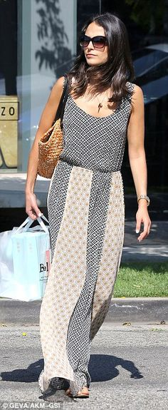 Simple but stylish: The Dallas star smiled as she wandered around town in her floaty long dress, paired with brown sandals