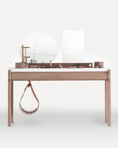 Vanity hub for two: His & Her Dressing Table by Studio248 offers an elegantly modern marble surface, ridge-cut to fit a collection of solid wood personal accessory organizers, linearly arranged for at-a-glance selection, in front of dual mirrors for her close make-up work and his quick check.