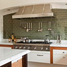 Hanging stuff on the backsplash behind the stove seems convenient