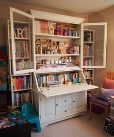 """Today I am sharing a beautiful craft room with you all. Gina Lee Kim's studio is a gorgeous space that is sure to inspire. She was able to incorporate all of her own art supplies in a functional desk hutch that stores a ton of supplies in a relatively small space, as well as include … Continue reading """"Craft Room {Gina Lee Kim}"""""""