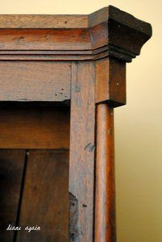living room. black walnut cupboard. detail. top molding.