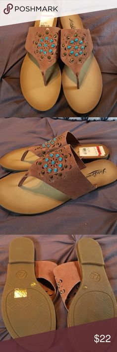 Lucky brand Breese sandal. NWT. Size 8 Lucky brand Breese leather sandal. NWT. Size 8.  Sandals have turquoise stones and studs on them. Brand new never worn.Size 8 Lucky Brand Shoes Sandals
