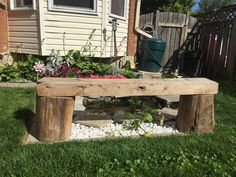 Seating bench made with logs and old barn wood shelf