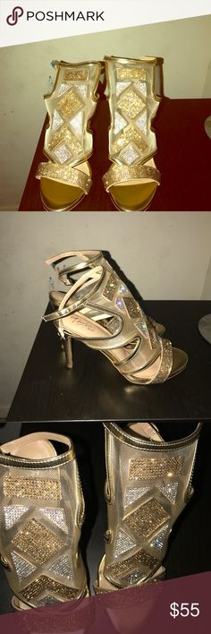 Gold heels Gold heels with ankle strap and gold and silver rhinestone designs.Only worn once Shoes Heels